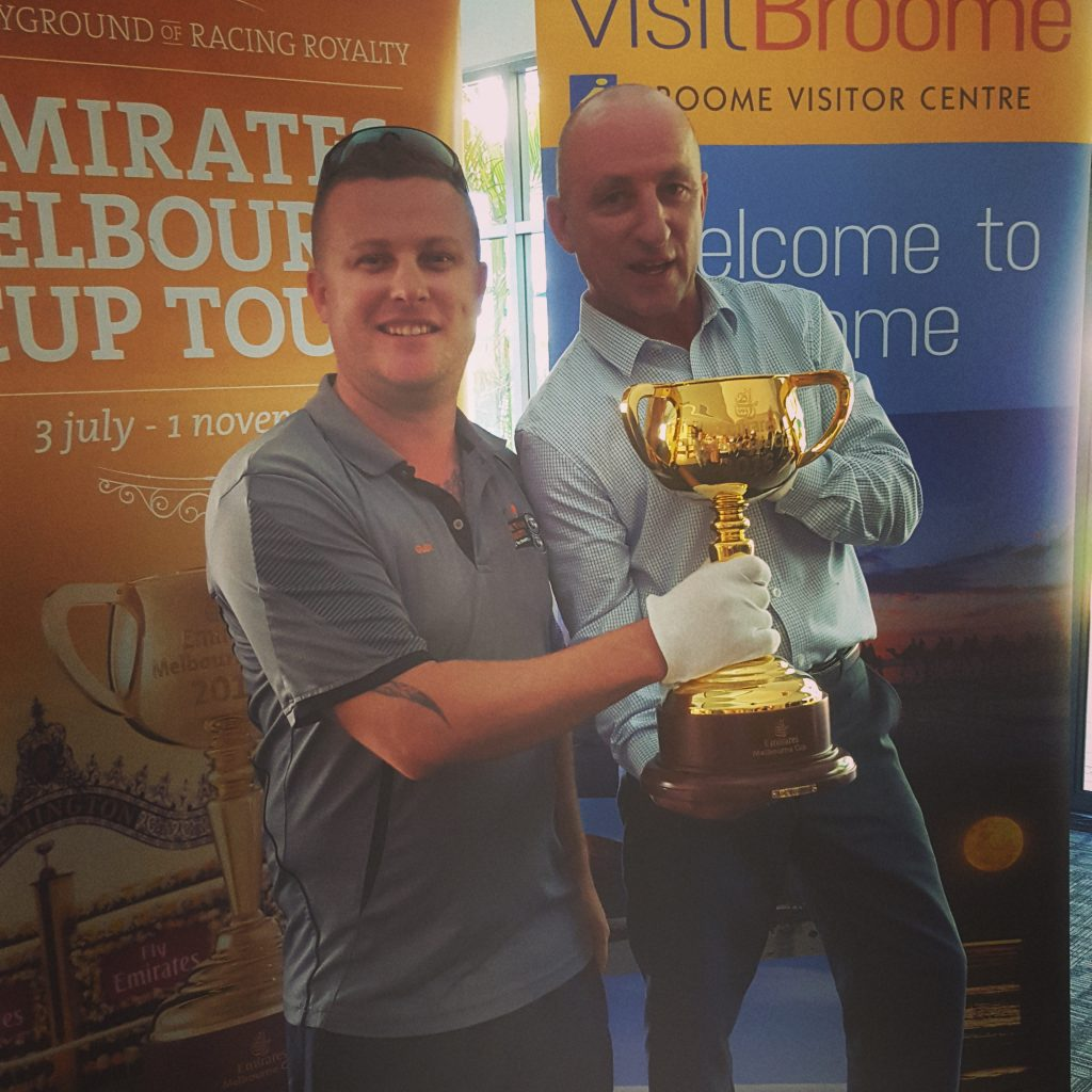 "Our Technical Director ""Glen"" with the Melbourne cup whilst running the audio/visual at a local event"